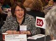 Patricia Koehler, J.R. Custom Metal Products Inc., talks with mentees at the WBJ's Bizwomen Mentoring Monday.