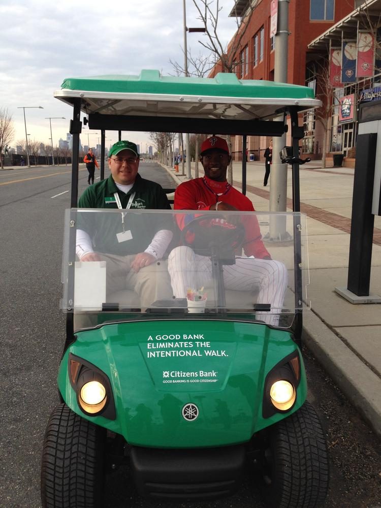 Phillies outfielder Domonic Brown takes a ride on the Citizens Bank golf cart.