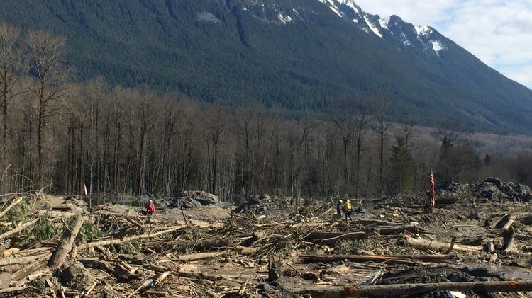Search and rescue crews continue recovery efforts at site of Oso mudslide on April 1. President Obama will visit families and responders involved in the disaster later this month.