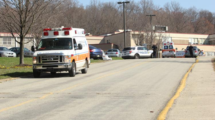An ambulance leaves Franklin Regional High School while another one arrives following the multiple stabbings Wednesday morning at the school.
