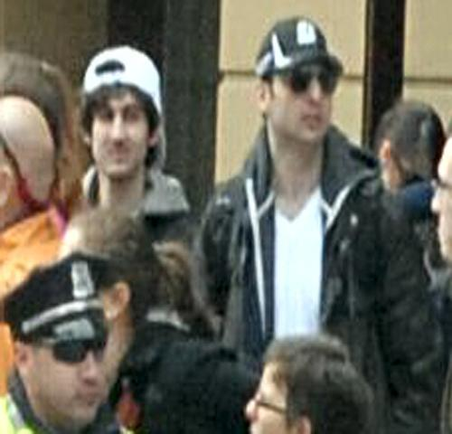 """Suspects Together"", as labeled by the Federal Bureau of Investigation (FBI), are seen in this handout photo taken from video surveillance in Boston, Massachusetts, U.S., on the day of the bombings and released to the media on Friday, April 19, 2013. The FBI released photos and video of two suspects in the Boston Marathon bombings and appealed for the public's help in their capture. Early this morning, the agency released additional photos that showed the faces of the suspects. Source: FBI via Bloomberg  EDITOR'S NOTE: EDITORIAL USE ONLY. NO SALES."