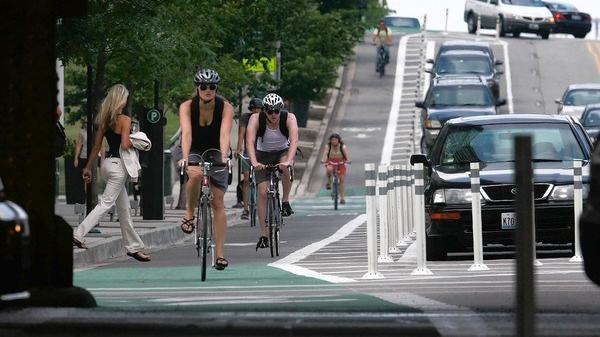 White plastic poles and - for most of the day - a parking lane will separate bicycle riders from vehicle traffic on Central Parkway if the planned cycle path is created. Cincinnati Mayor John Cranley has directed that contracts for the project be put on hold.