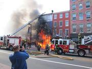 Less than a month after the demolition and collapse of the iconic Shirt Corner in Old City Philadelphia, its counterpart on the diagonal corner, the Suit Corner was engulfed by fire on April 9.