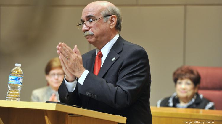 Charlotte Mayor Dan Clodfelter acknowledges applause from the audience after his speech Wednesday at the Government Center.