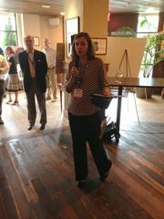 Amy Watkins, a retail real estate broker for York Properties in Raleigh and regional director for The Retail Bus Tour, addresses the crowd of tour participants at the Mia Francesca restaurant at North Hills on the final stop on the day-long bus tour.