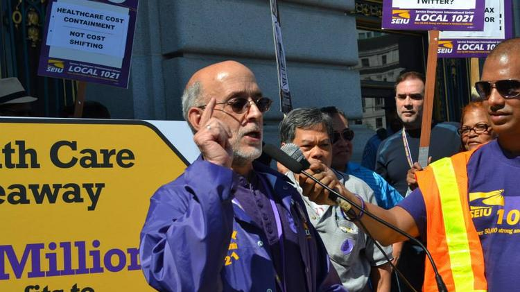 Larry Bradshaw is vice president of SEIU's Local 1021 and a San Francisco paramedic. Here he speaks outside City Hall at a recent rally against tax breaks for wealthy corporations.