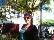 "Deanna Bowdish, whose ""Cascading Colors"" cast-resin designs hung in a rainbow of colors and patterns from the trees in Hemming Plaza and down Laura Street."