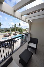 The balcony of the two bedroom villa overlooking the private pool area.