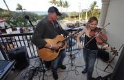 Amber Leigh and Randy James perform on the second floor balcony at the opening party.
