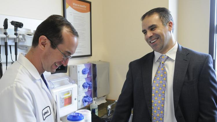 Dr. Joseph Jasser, president and CEO, Dignity Health Medical Foundation, right, shares a laugh with Dr. Robert Kirchner.