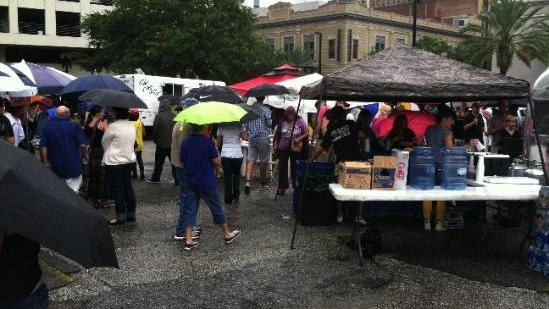 Burrito Gallery's parking lot, at the corner of Main and Adams streets, was filled for a food truck rally in 2012. Jaxsons Food Market will be held on the site the third Thursday of every month with the goal of bringing more foot traffic to the urban core.