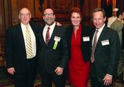 Winner Mitchell Schwartz of SMARTSolution Technologies and his wife Elaine Stone are flanked by guests Larry Lewis, far left, and David Cohen.