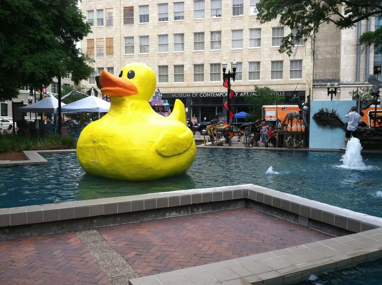 A giant duck floating in Hemming Plaza.