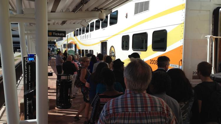 Business folks, residents and downtown fans gathered at Church Street Station for a SunRail train tour.