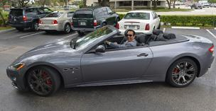 R. Alexander Gomez in his new Maserati he bought after selling New Wave Surgical.