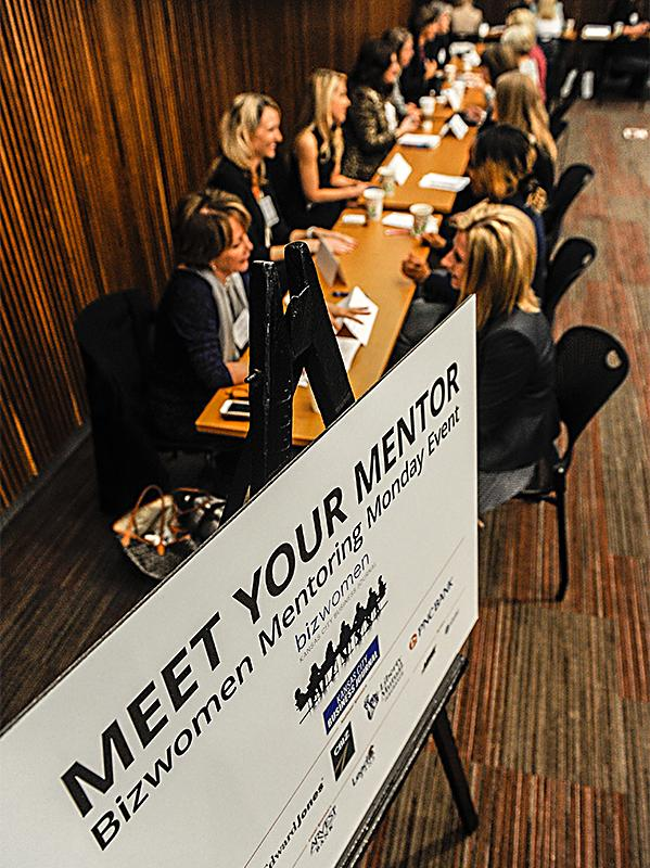 Attendees engage in one-on-one meetings with mentors.