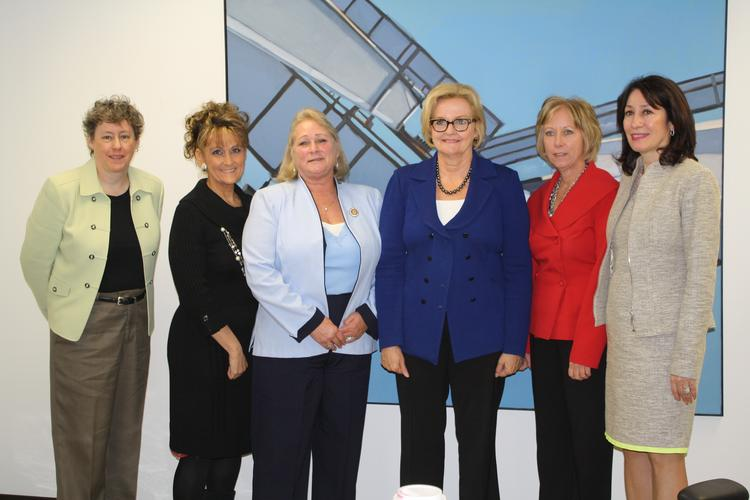 From left to right: Jami Henry, president of Bellewether; Denise Farris, regional coordinator for Women Impacting Public Policy; Colleen White, president of Strategic Workplace Solutions Inc.; U.S. Senator Claire McCaskill; Sherry Turner, founder of OneKC for Women and president of Women's Employment Network; and Rosana Privitera-Biondo, president of Mark One Electric Co. Inc. and national president of Women Construction Owners and Executives.