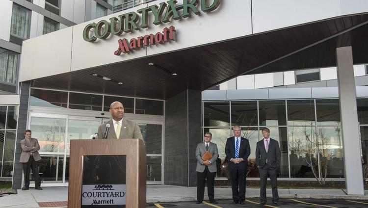 Mayor MIchael Nutter at the unveiling of the Navy Yard's first hotel, a Courtyard by Marriott. Behind him were Ed Proenza of Ensemble Hotel Partners, John Grady of PIDC and David Marriott of Marriott International.