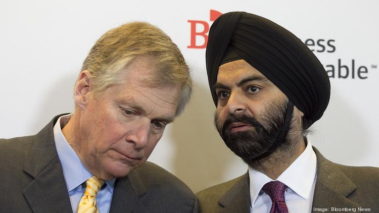 MasterCard CEO Ajay Banga, right, seen here talking to Caterpillar CEO Douglas Oberhelman, praised federal officials for clarifying that antitrust concerns should not keep companies from sharing information about cybersecurity threats.