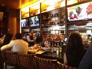 The Capital Grille put an emphasis on creating a separate bar area, so that shoppers at The Mall at Millenia would feel comfortable coming in for appetizers and drinks instead of a full fine dining experience.