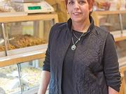 Bonnie Scible, owner of the Peanut Shoppe, is opposed to a State Center redevelopment.
