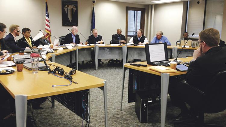 Members of the Mayor's KCI Advisory Board deliberate about what to do with the airport. They met April 8 at City Hall.