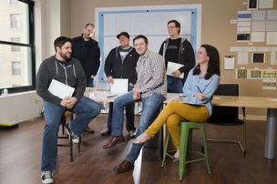 Robin Rath (center), Founder and CEO of Pixel Press poses for a photograph with his development team in their office on March 31, 2013 in St. Louis, Missouri.