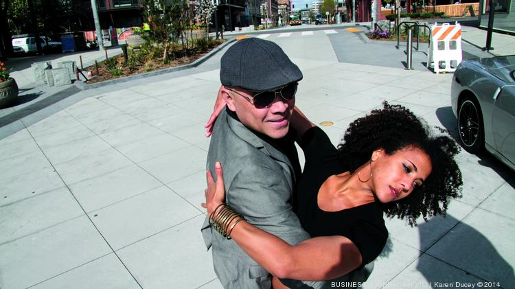 Jim Chow, (left) owner of the Bell Town Dance Studio and his dance partner Camille Primous, a salsa dance instructor, hold a pose on Bell St., in Seattle, Wash. on March 2, 2014. The official opening of the new Bell Street Park project will be April 12 from 2 - 5pm. The park runs from 1st Ave. through 5th Ave. The new street design will encourage pedestrains, cyclists, and automobiles to sahre the same space.