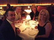 Kissimmee Realtor Rajia Ackley, front right, and her guests enjoy the preview dinner at The Capital Grille on April 17.