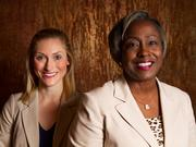 Sasha Kuchinski, communications representative for INTRUST Bank, and Junetta Everett, vice president for professional relations at Delta Dental of Kansas, Inc.