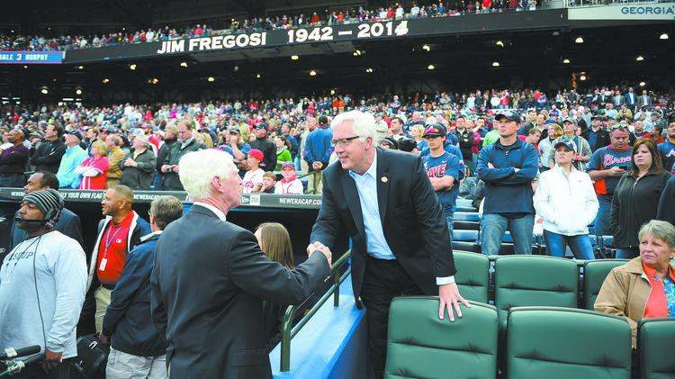 Braves Chairman and CEO Terry McGuirk, left, greets Cobb Commission Chair Tim Lee at the Braves' home opener. The Braves plan to move to Cobb in 2017.