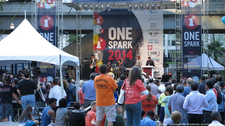 One Spark Executive Director Joe Sampson addresses the Hemming Plaza crowd during One Spark 2014 Opening ceremonies.