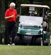 Bill Clinton finds that a golf cart helps his handicap as much as a mulligan. Clinton's handicap? About 12, give or take a mulligan.