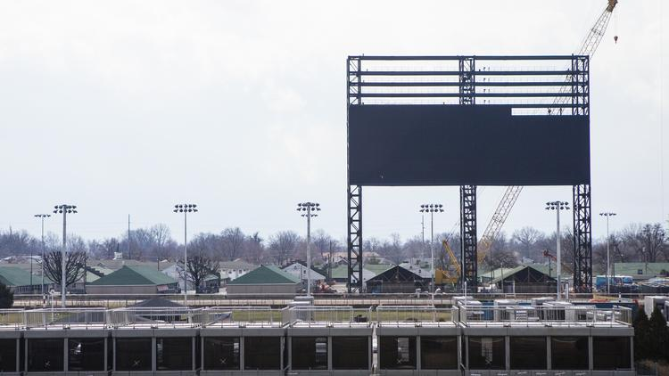 Construction crews have completed installation of a $12 million screen near the Churchill Downs racetrack's backside area.