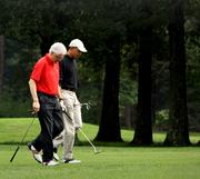 Presidents Barack Obama and Bill Clinton team up to drive down their handicaps. Obama has a handicap of 16.