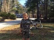 MaryBeth Mills Muldowney and the drone she bought last year to shoot pictures and video of homes from the sky.