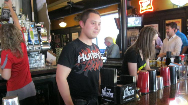 DBJ Reporter Tristan Navera was part of a bartending challenge at Brixx Ice Company to raise money for Dayton Children's Hospital's CARE House.