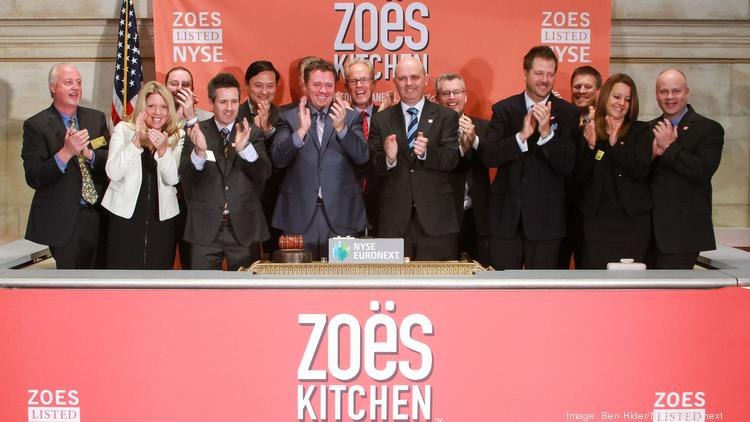 President and CEO Kevin Miles of Zoës Kitchen rings the opening bell at The New York Stock Exchange on April 11.  (Photo by Ben Hider/NYSE Euronext)