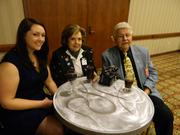 Carol Hebel, center, the 1992 Kentucky Derby Festival chairman, attended a reception at the They're Off! Luncheon with her granddaughter, Madeline Hebel, and husband, Charles Hebel.