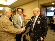 Jack Guthrie, left, greets Max Rein, center, and Jim Judy, outside the grand ballroom at the They're Off! Luncheon. Guthrie was executive vice president and CEO of the Kentucky Derby Festival Inc. during the 1970s. He and Rein were instrumental in starting the Kentucky Derby Festival Basketball Classic, which is holding its 40th game this year. Judy was president of the festival in 1981.