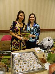Alice Baron, left, president of the Junior League of Louisville, and Lacinda Glover, cookbook co-chairman for the group, display the Junior League's new cookbook and samples from its recipes outside the They're Off! Luncheon.