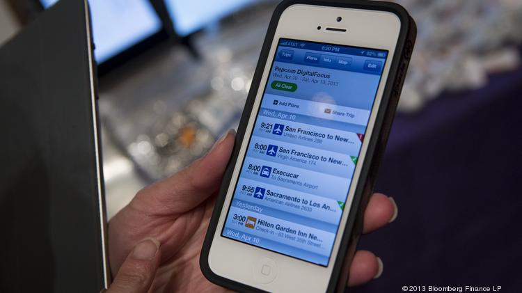 The TripIt mobile app is displayed on an Apple iPhone 5.