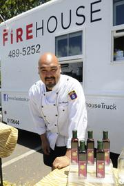 Eddie Mafnas, chef and owner of Firehouse, poses for a photo outside of his food truck. Mafnas is one of the food vendors at the LPGA LOTTE Championship.