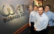 Wave Broadband CEO Steve Weed (center), Senior Vice President for Business Solutions Paul Koss (left) and Executive Vice President-IP and Business Solutions Patrick Knoor are pictured in Wave headquarters in Kirkland.