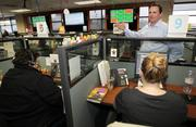 Wave Broadband CEO Steve Weed speaks to call center support staff in his company's central support center in Kirkland.