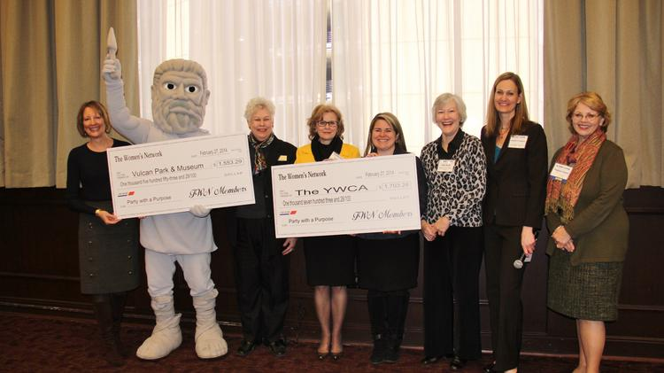 Members of The Women's Network present checks to the Vulcan Park and Museum and YWCA Central Alabama.