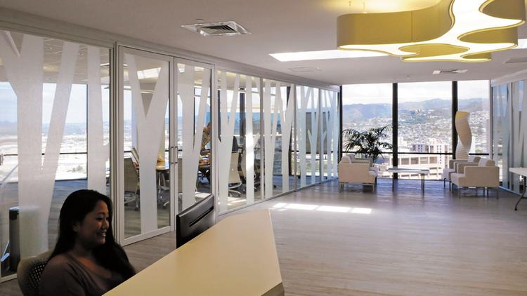 The lobby area of Architects Hawaii Ltd.'s space on the penthouse floor of the Pacific Guardian Center features two large conference rooms with a sitting area in between. The view of Honolulu Harbor and the Pacific Ocean beyond is so good that the firm keeps a pair of binoculars handy for whale watching.