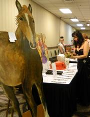 Lisa Poschinger checked out the silent auction items at The Fillies Derby Ball.