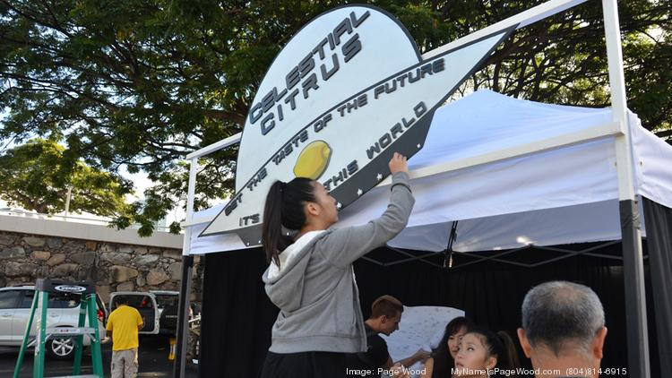 The #kidpreneur team from Celestrial Citrus sets up its booth for the Lemonade Alley competition at Pearlridge Center on Oahu. The team won the grand prize in the fifth grade through eighth grade category, which included a $1,000 prize.