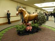 """Various horse displays contributed to the decor at The Fillies Derby Ball in a hallway outside the grand ballroom of The Galt House hotel. The theme of the ball was """"Galloping with the Fillies."""""""